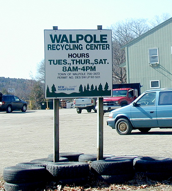 sign at Center showing days and hours open
