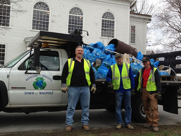 recycling crew in front of truck loaded with picked-up trash